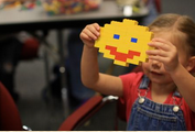 Child_with_Build_toy_brick_happy_face